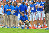 Florida Gator head coach Will Muschamp, QB Tyler Murphy, and other coaches watch from the sideline in the second quarter.  Florida Gators vs Georgia Southern Eagles.  Gainesville, FL.  November 23, 2013.