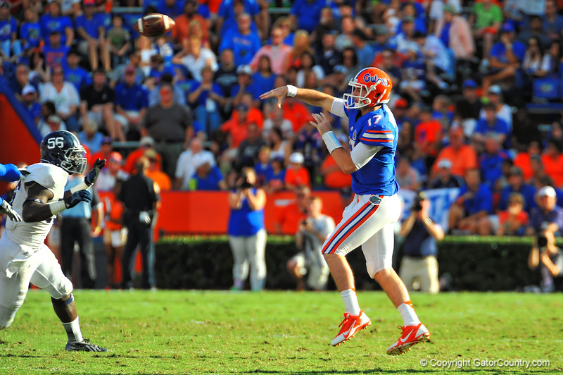 Florida Gator QB Skyler Mornhinweg jumps and throws to the open receiver in the flat in the second quarter.  Florida Gators vs Georgia Southern Eagles.  Gainesville, FL.  November 23, 2013.