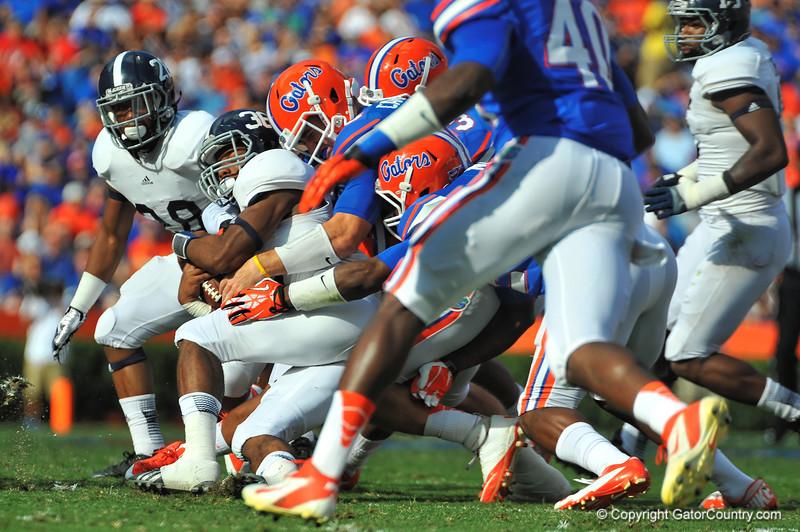 The Florida Gator defense converge on Georgia Southern RB Matt Breida.  Florida Gators vs Georgia Southern Eagles.  Gainesville, FL.  November 23, 2013.