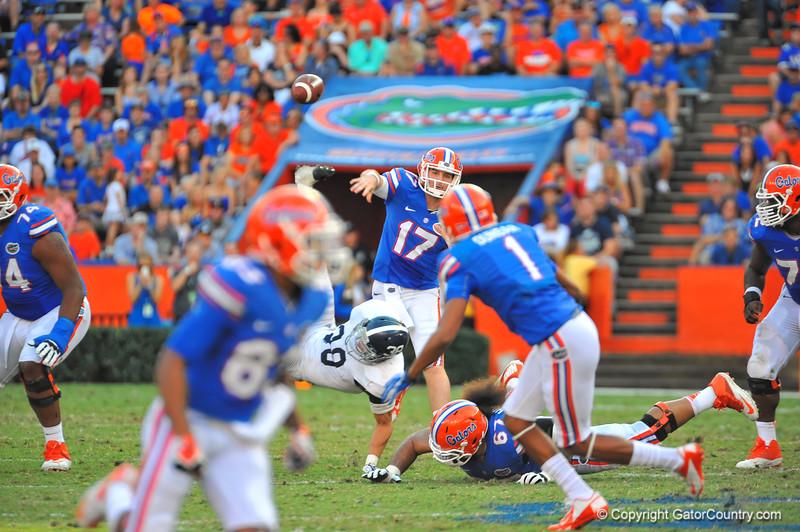 Florida Gator QB Skyler Mornhinweg throws downfield to an open Quinton Dunbar.  Florida Gators vs Georgia Southern Eagles.  Gainesville, FL.  November 23, 2013.