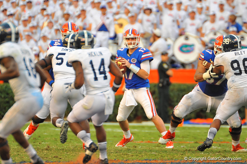 Florida Gator QB Skyler Mornhinweg looks downfield trying to lead the Gators to a fourth quarter comeback.  Florida Gators vs Georgia Southern Eagles.  Gainesville, FL.  November 23, 2013.
