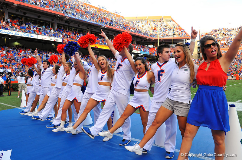 The Florida Gator cheerleaders sing the Alma Matter during the third quarter intermission.  Florida Gators vs Georgia Southern Eagles.  Gainesville, FL.  November 23, 2013.