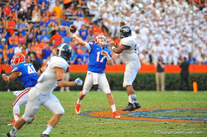 Florida Gator QB Skyler Mornhinweg throws deep downfield to an open Solomon Patton for the touchdown to tie the game 20-20 in the fourth quarter.  Florida Gators vs Georgia Southern Eagles.  Gainesville, FL.  November 23, 2013.