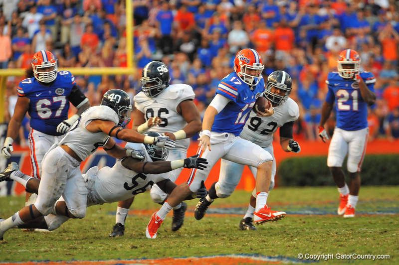 Florida Gator QB Skyler Mornhinweg scrambles downfield to pick up the first down late in the fourth quarter.  Florida Gators vs Georgia Southern Eagles.  Gainesville, FL.  November 23, 2013.
