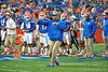 Florida Gator offensive coordinator Brent Pease joins in on the drills during warm ups for the Georgia Southern game.  Florida Gators vs Georgia Southern Eagles.  Gainesville, FL.  November 23, 2013.