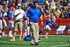 Florida Gator head coach Will Muschamp walks around the field watching his team warm up prior to the start of the game against Georgia Southern.  Florida Gators vs Georgia Southern Eagles.  Gainesville, FL.  November 23, 2013.