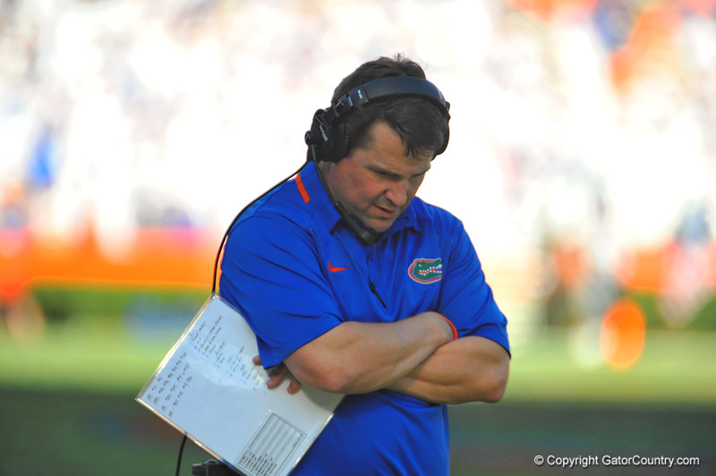 Florida Gator head coach Will Muschamp walking the sideline.  Florida Gators vs Georgia Southern Eagles.  Gainesville, FL.  November 23, 2013.