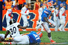 Florida Gator RB Kelvin Taylor avoids the tackle and sprints to get to the outside.  Florida Gators vs Georgia Southern Eagles.  Gainesville, FL.  November 23, 2013.