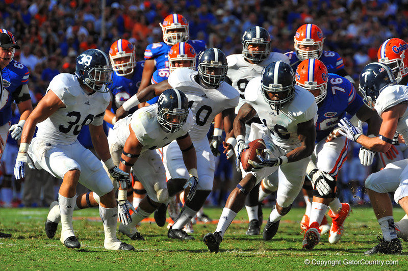 Georgia Southern safety Antonio Glover picks up the blocked field goal attempt.  Florida Gators vs Georgia Southern Eagles.  Gainesville, FL.  November 23, 2013.