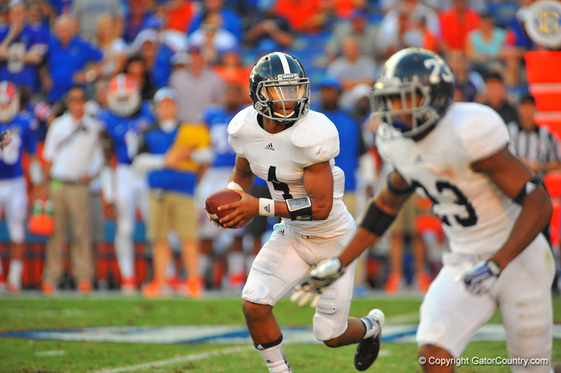 Georgia Southern QB Kevin Ellison bootlegs to the right in the second quarter.  Florida Gators vs Georgia Southern Eagles.  Gainesville, FL.  November 23, 2013.