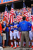 The Florida Gators bearing American flags to salute those who serve prepare to take the field.  Florida Gators vs Georgia Southern Eagles.  Gainesville, FL.  November 23, 2013.