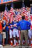 The Florida Gators bearing American flags to salute those who serve prepare to take the field.  Florida Gators vs Georgia Southern Eagles.  Gainesville, FL.  November 23, 2013.