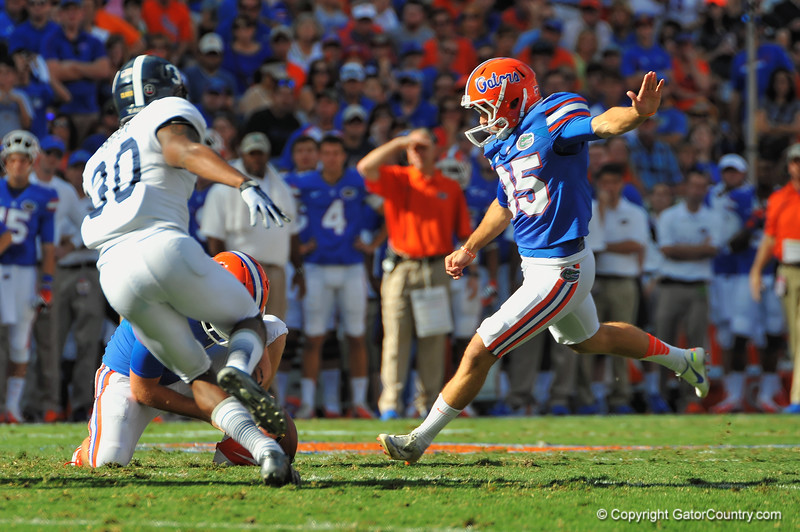 Florida Gator kicker Frankie Velez kicks in the field goal to put the Gators up 3-0 in the first quarter.  Florida Gators vs Georgia Southern Eagles.  Gainesville, FL.  November 23, 2013.