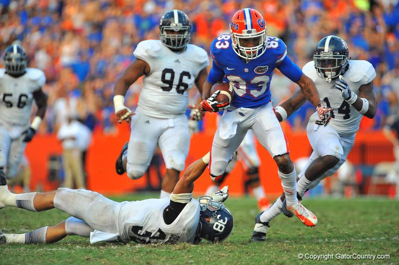 Florida Gator WR Solomon Patton hurdles Georgia Southern LB Kyle Oehlbeck the fourth quarter.  Florida Gators vs Georgia Southern Eagles.  Gainesville, FL.  November 23, 2013.