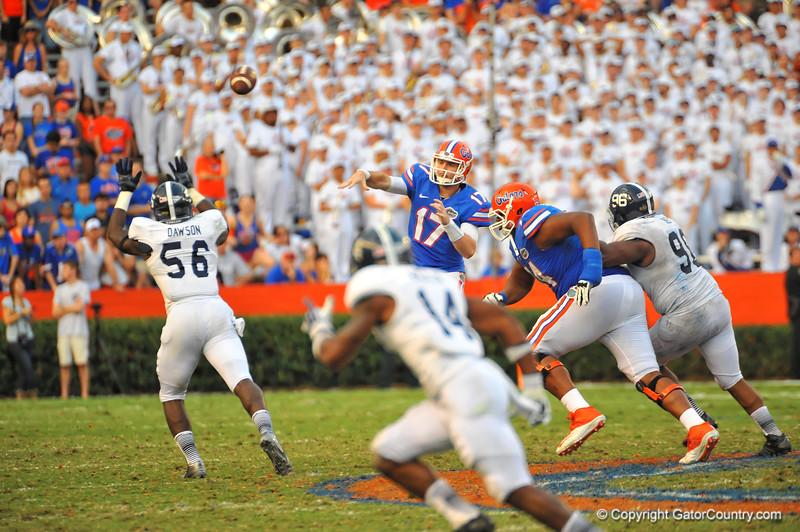 Florida Gator QB Skyler Mornhinweg throws downfield trying to lead the Gators to a fourth quarter comeback.  Florida Gators vs Georgia Southern Eagles.  Gainesville, FL.  November 23, 2013.