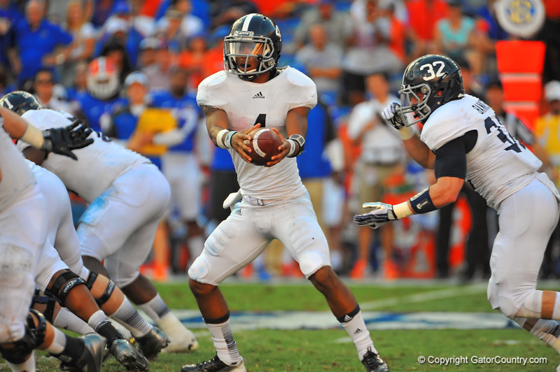 Georgia Southern QB Kevin Ellison looks to hand off the ball in the second quarter.  Florida Gators vs Georgia Southern Eagles.  Gainesville, FL.  November 23, 2013.