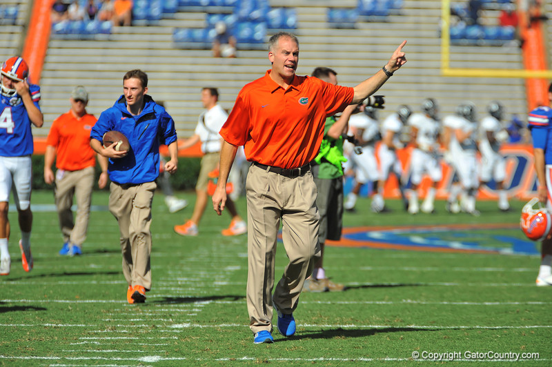 Florida Gator defensive coordinator DJ Durkin during warmups for the Georgia Southern game.  Florida Gators vs Georgia Southern Eagles.  Gainesville, FL.  November 23, 2013.