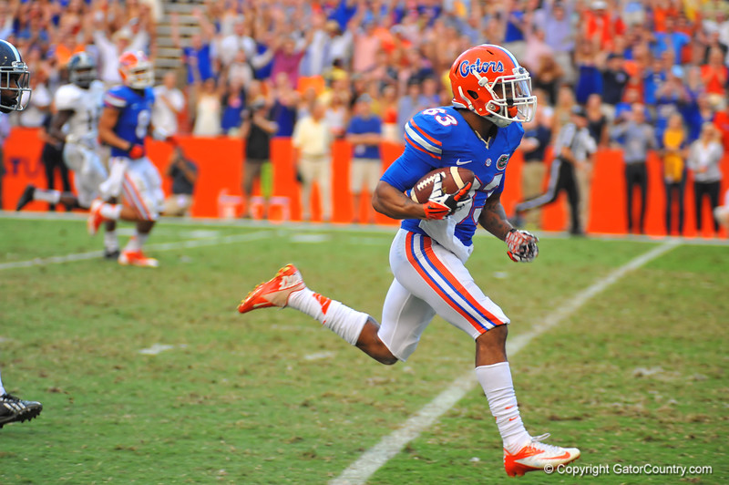 Florida Gator WR Solomon Patton catches the pass and sprints into the endzone to tie the game 20-20 in the fourth quarter.  Florida Gators vs Georgia Southern Eagles.  Gainesville, FL.  November 23, 2013.