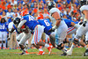Florida Gator LB Darrin Kitchens make the tackle on Georgia Southern QB Kevin Ellison.  Florida Gators vs Georgia Southern Eagles.  Gainesville, FL.  November 23, 2013.