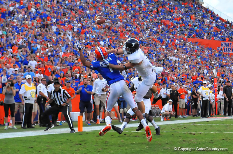 Florida Gator WR Quinton Dunbar being defended by Georgia Southern safety Matt Dobson jumps trying to catch the late touchdown pass but is unable to come down with it.  Florida Gators vs Georgia Southern Eagles.  Gainesville, FL.  November 23, 2013.