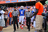 Florida Gator DL Dante Fowler and the rest of the captains are escorted to mid field by the referees for the coin toss.  Florida Gators vs Georgia Southern Eagles.  Gainesville, FL.  November 23, 2013.