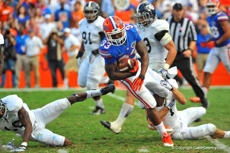 Florida Gator RB Mack Brown is tripped up.  Florida Gators vs Georgia Southern Eagles.  Gainesville, FL.  November 23, 2013.