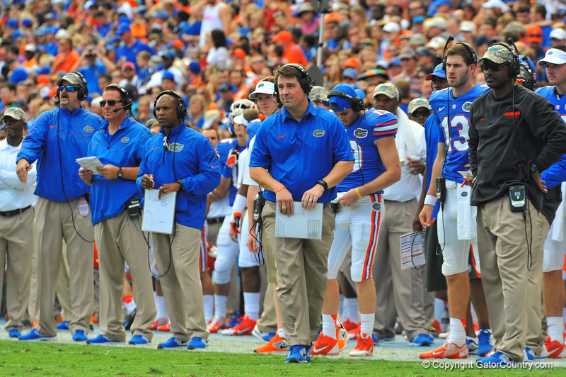 The Florida Gator coaching staff from left to right, Tim Davis, Brian White, Joker Phillips, Will Muschamp and Derek Lewis watch from the sideline during the second quarter.  Florida Gators vs Georgia Southern Eagles.  Gainesville, FL.  November 23, 2013.