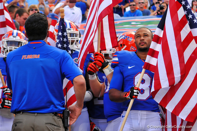 Florida Gator wide receiver Trey Burton holds up an American flag as they prepare to take the field.  Florida Gators vs Georgia Southern Eagles.  Gainesville, FL.  November 23, 2013.