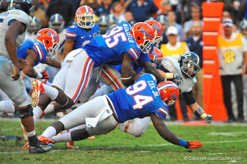 The Florida Gator defense swarm Georgia Southern FB William Banks for the tackle.  Florida Gators vs Georgia Southern Eagles.  Gainesville, FL.  November 23, 2013.