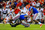 The Gator defense make the tackle.  Florida Gators vs Georgia Bulldogs.  EverBank Field.  November 2, 2013.