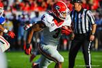 Georgia RB Todd Gurley avoids the tackles by Gator LB Michael Taylor and runs downfield.  Florida Gators vs Georgia Bulldogs.  EverBank Field.  November 2, 2013.