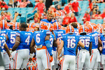 The Gator football team team gathers at midfield and raises defensive back Loucheiz Purifoy up above them.  Florida Gators vs Georgia Bulldogs.  EverBank Field.  November 2, 2013.