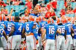 The Gator football team team gathers at midfield and raises defensive back Loucheiz Purifoy up above them.  Florida Gators vs Georgia Bulldogs.  EverBank Field.  November 2, 2013.