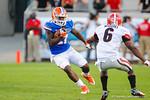 Florida running back Kelvin Taylor cuts back right to avoid the tackle in the third quarter.  Florida Gators vs Georgia Bulldogs.  EverBank Field.  November 2, 2013.