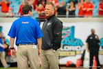 Florida head coach Will Muschamp talks with Georgia head coach Mark Richt.  Florida Gators vs Georgia Bulldogs.  EverBank Field.  November 2, 2013.