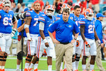 Florida head coach Will Muschamp watches on as hs team warms up for the Florida/Georgia football game.  Florida Gators vs Georgia Bulldogs.  EverBank Field.  November 2, 2013.