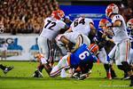 Florida DL Date Fowler tackles Georgia RB Todd Gurley.  Florida Gators vs Georgia Bulldogs.  EverBank Field.  November 2, 2013.