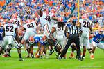 Georgia defensive players jump to block the Gator field goal attempt.  Florida Gators vs Georgia Bulldogs.  EverBank Field.  November 2, 2013.