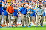 The Florida coaching staff watches on from sideline.  Florida Gators vs Georgia Bulldogs.  EverBank Field.  November 2, 2013.