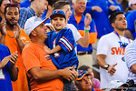 A father and son are all smiles after the gators climb back into the game.  Florida Gators vs Georgia Bulldogs.  EverBank Field.  November 2, 2013.