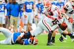 Gator linebacker Daniel McMillian (13) tackles Georgia TB JJ Green on the opening kickoff.  Florida Gators vs Georgia Bulldogs.  EverBank Field.  November 2, 2013.