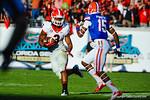 Georgia RB Todd Gurley (3) looks to avoid Gator DB Loucheiz Purifoy (15).  Florida Gators vs Georgia Bulldogs.  EverBank Field.  November 2, 2013.