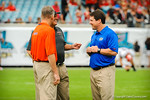 Gator head coach Will Muschamp talking with D.J Durkin and a Georgia coach prior to the start of the Florida-Georgia game.  Florida Gators vs Georgia Bulldogs.  EverBank Field.  November 2, 2013.