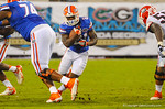 Florida RB Kelvin Taylor cuts left and tries to run through the open hole.  Florida Gators vs Georgia Bulldogs.  EverBank Field.  November 2, 2013.