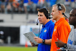 Florida coaches Will Muschamp and DJ Durkin call in the play from the sideline.  Florida Gators vs Georgia Bulldogs.  EverBank Field.  November 2, 2013.