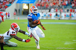 Florida running back Mack Brown sprints around the right side and dives in for the first gator touchdown.  Florida Gators vs Georgia Bulldogs.  EverBank Field.  November 2, 2013.
