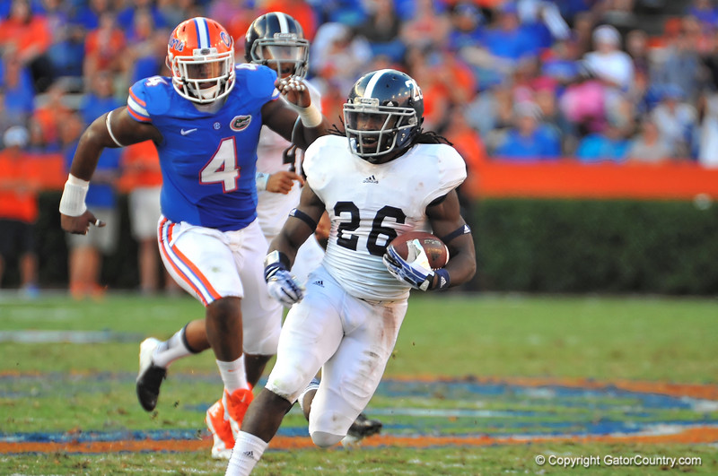 Georgia Southern SLOT Tray Butler gets the pitch and sprints upfield for a large gain in the third quarter against the Gators.  Florida Gators vs Georgia Southern Eagles.  November 23, 2013.  Gainesville, FL.