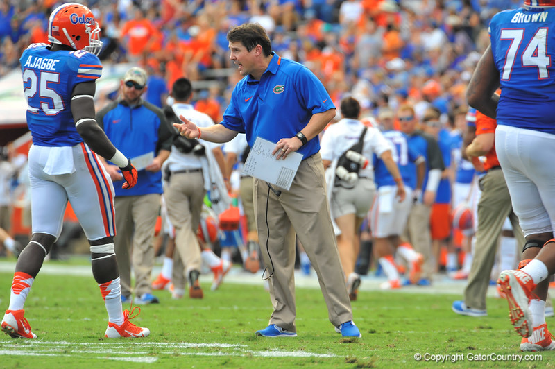 Florida Gator head coach Will Muschamp has some words for Gator fullback Gideon Ajagbe.  Florida Gators vs Georgia Southern Eagles.  November 23, 2013.  Gainesville, FL.