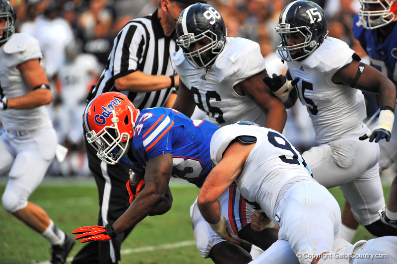 Florida Gator running back Mack Brown is tackled.  Florida Gators vs Georgia Southern Eagles.  November 23, 2013.  Gainesville, FL.