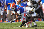 Florida Gator QB Tyler Murphy is tackled by a diving Vanderbilt DB Andre Hal.  Florida Gators vs Vanderbilt Commodores.  Gainesville, FL.  November 9, 2013.